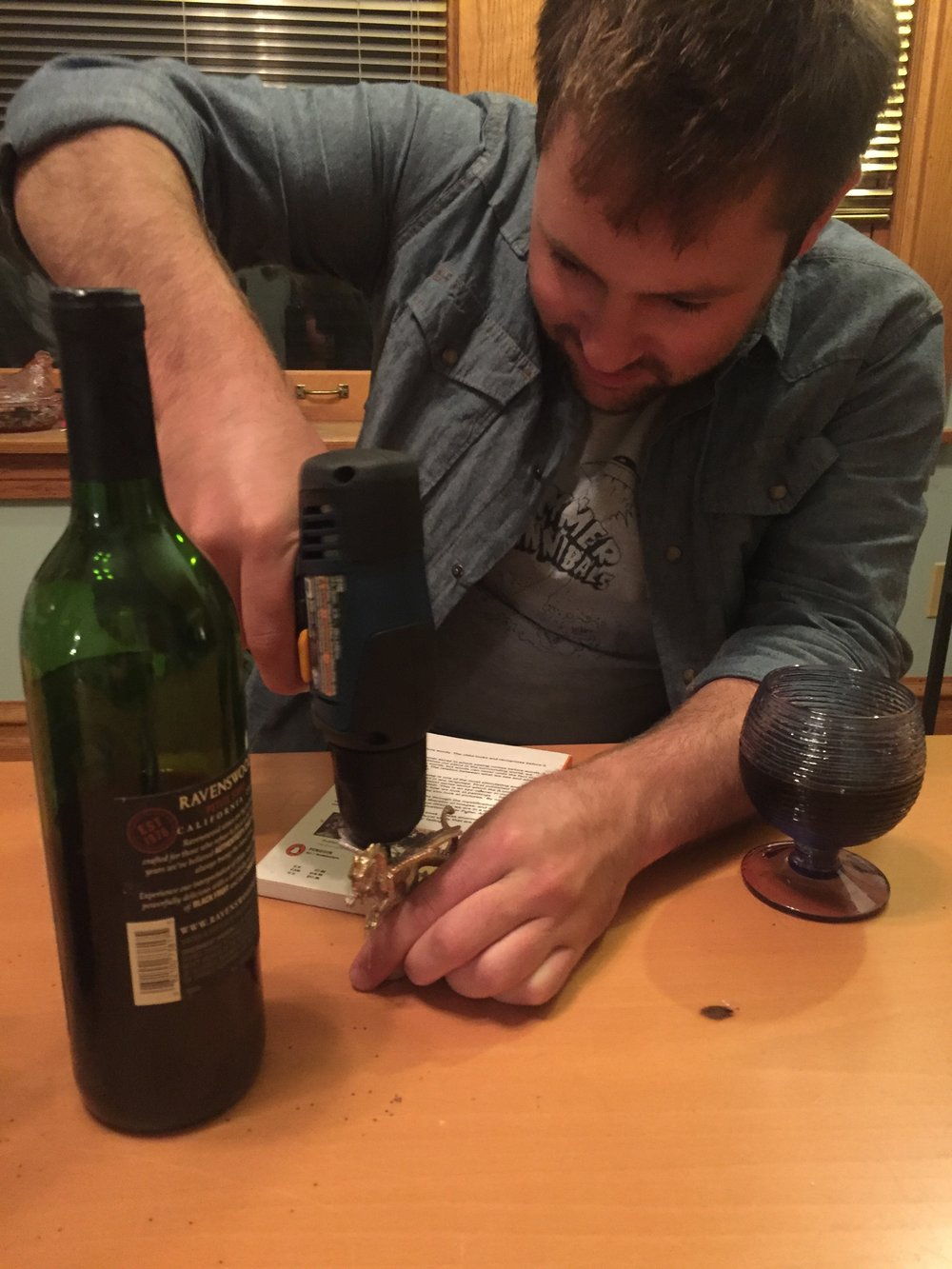 He should probably be wearing safety things and not just holding the cork with his bare hands. Buuuuut, ya know.
