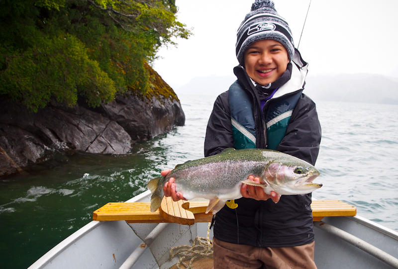 Greger lands a tough Rainbow midging along the edges of the cliffs on the lake.