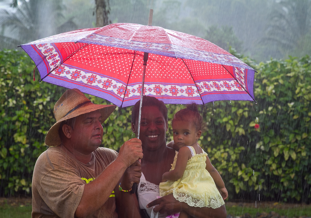 Family in the rain, Vinales, Cuba