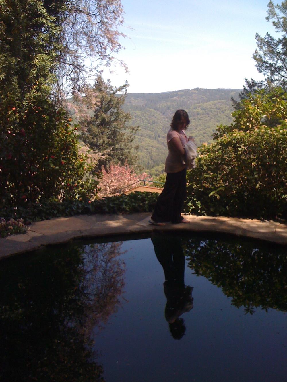 Jill looks into the pond at Ananda Tulip Gardens. Nevada City, California. 25 April 2010.