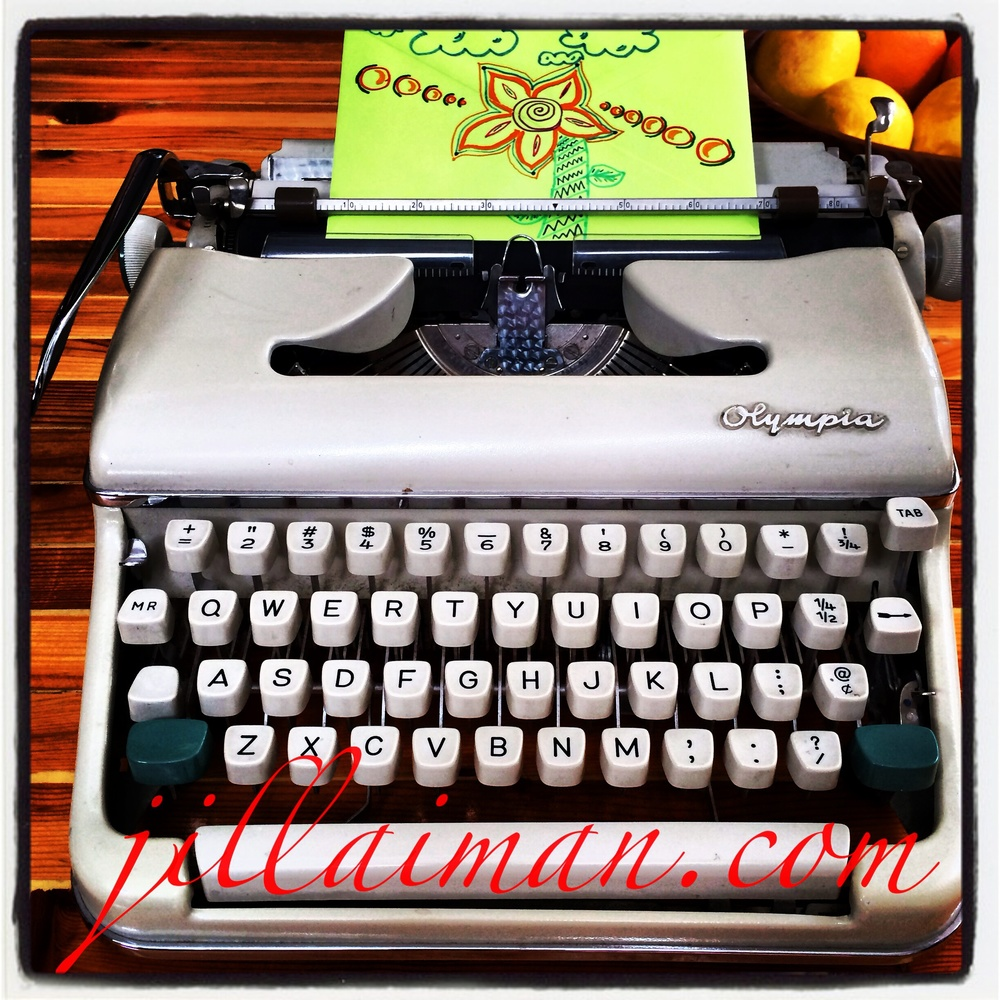 A decorated envelope ready to be sent out to a friend, rests a top my Mother's 1967 Olympia typewriter. 1 March 2014.