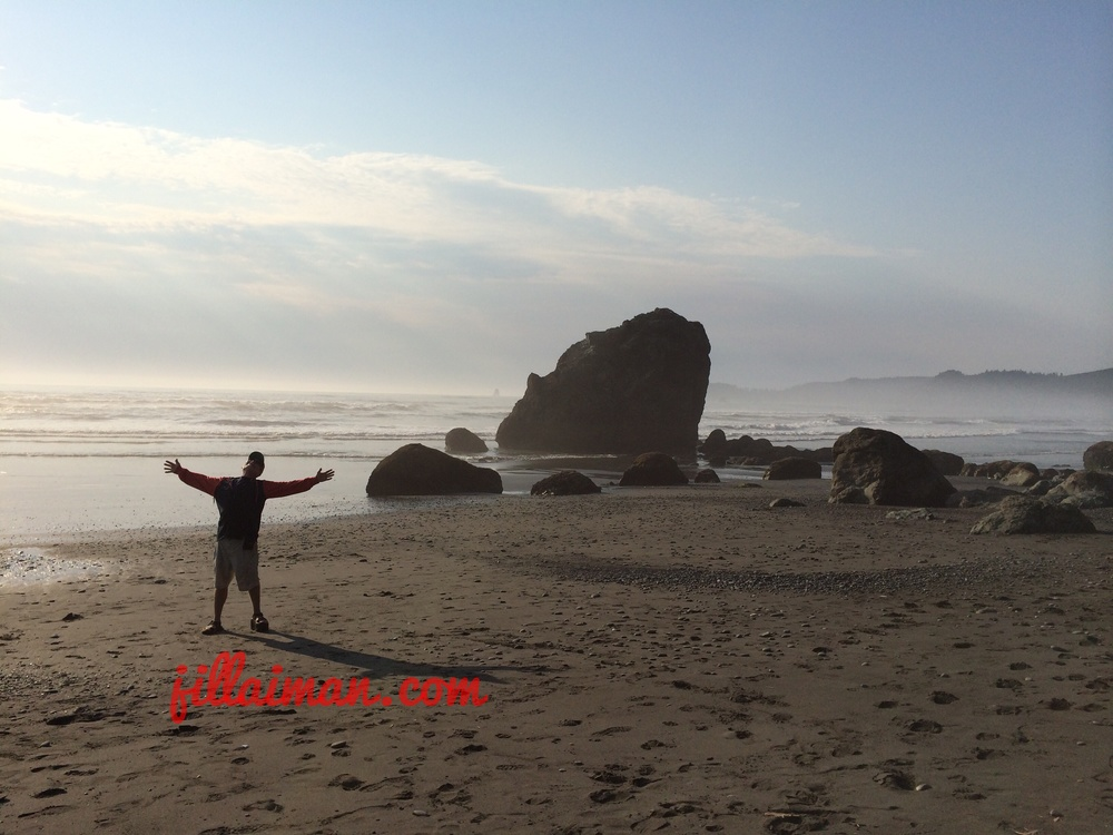 Marc raises his hands to the sky.  Ruby Beach, Olympic National Park.  11 August 2014.
