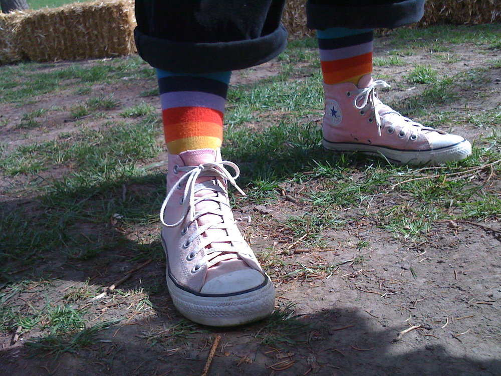 Accessorize with Bright Colors.  It's a Feel Good way to brighten up your day.  Pink Converse High-Tops with Rainbow striped socks.  Moscow, Idaho.  2009.