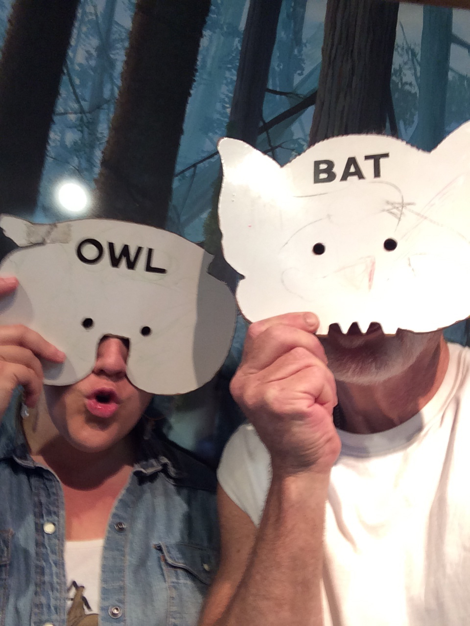 Being Silly is Feel Good.  Jill and Marc try on Owl and Bat masks at the Olympic National Park visitors center.  Port Angeles, Washington.  August 2014.