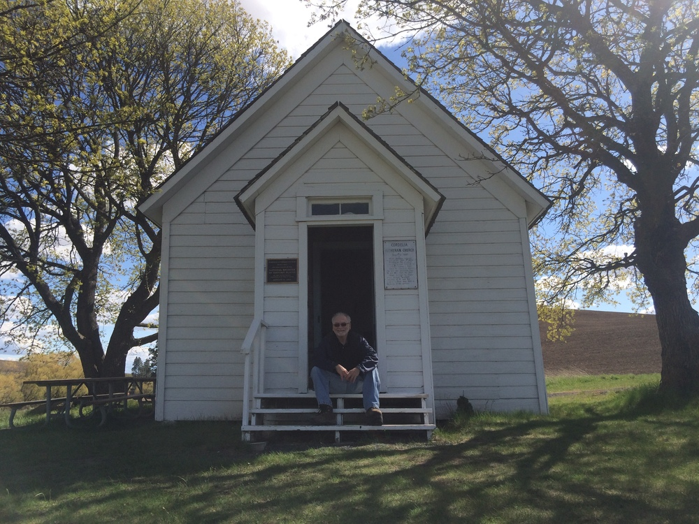 Marc sits on the steps of The Cordelia Lutheran Church on a sunny Sunday in April.