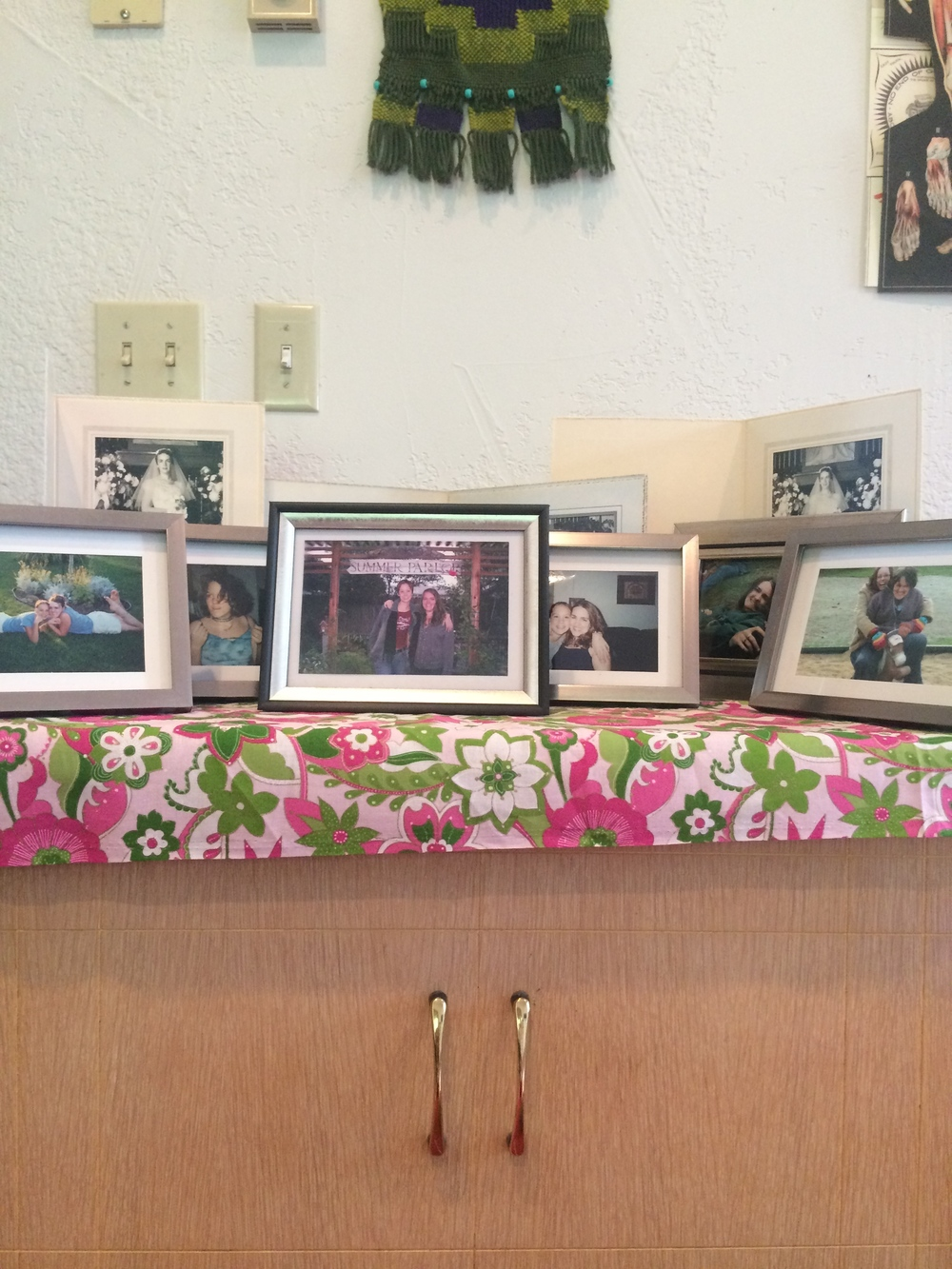 All objects seem to have story, don't they?  The story these objects tell revolve around women in my life, and how they loved and supported me during my wedding.  The cedar chest belonged to my Aunt Jeanette.  The colored photographs were amassed and framed by Leah in honor of our friendship for my bridal shower.  The black and white photographs peeking up from the back are of my Aunt Jeanette at her first wedding, she was 19 years old.  The flowered fabric, pink and green, was part of my bridal shower gift from Erica.