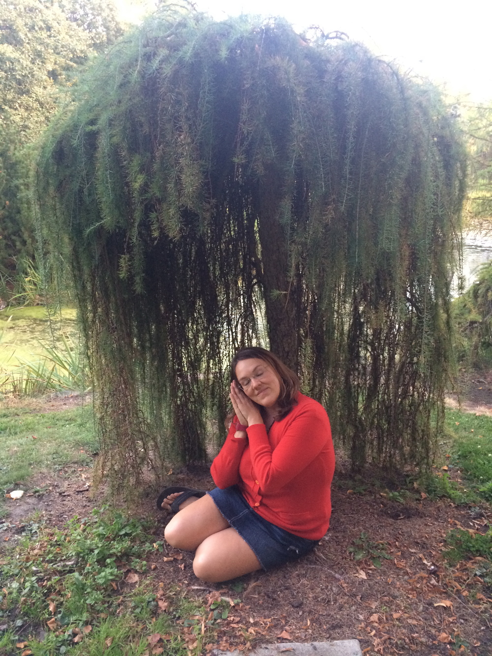 Jill is held in embrace of the trees branches. University of Idaho Arboretum. September 2014.