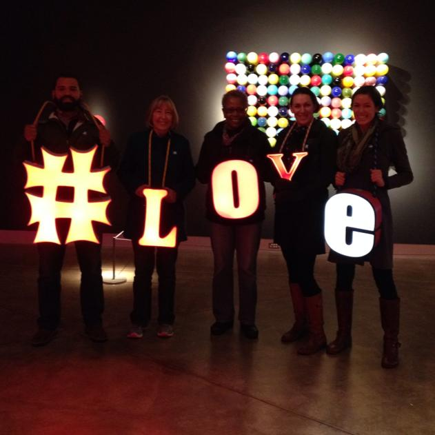 Guest Writer, Kim (fourth from left) is pictured with her family at the Tacoma Museum of Glass.  They chose to spell #love with the light up letters, which were part of an interactive art installation.