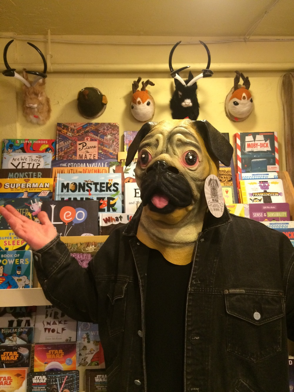 Marc models a pug mask at  Boo Radley's in Spokane, WA , during one of our scout around town outings. (PS. Aren't those jackalopes awesome? I love jackalopes, they're one of my spirit animals...just ask my Dad, Donald.)