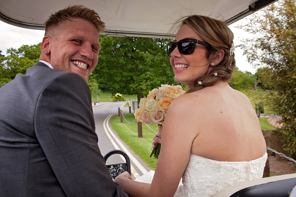 Switching out the wedding transport for a golf cart, much easier to navigate Breadsal Priory with.