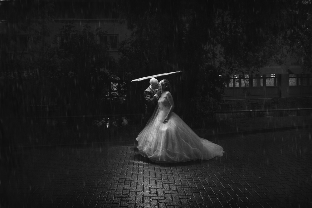 Embracing the rain and dealing with the lack of lighting with one of our big studio umbrellas with a crafty light fixed inside, keep dry and light in one on the fly fix.