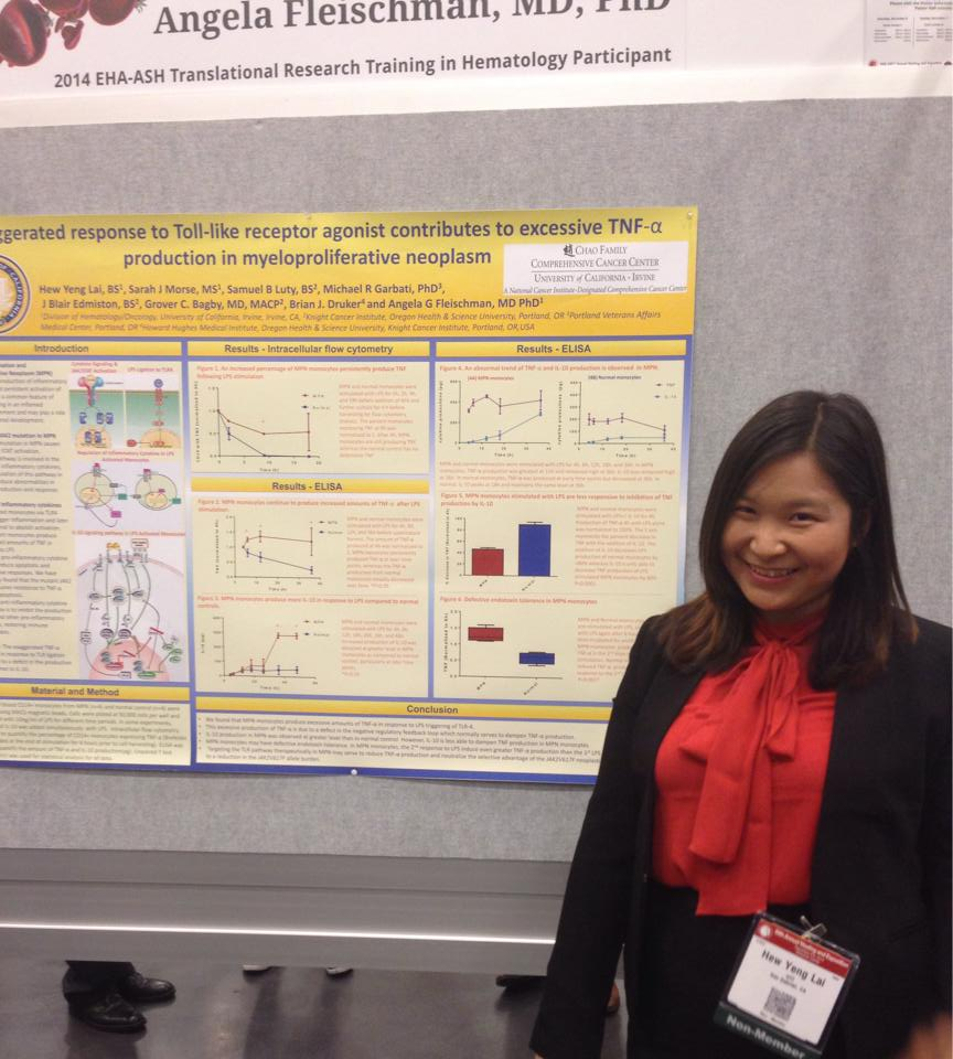 Betty next to her poster at Monday night's poster session.