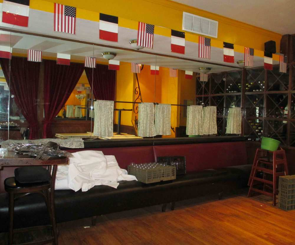 BEFORE: Busy flags and curtains make the space feel cluttered.