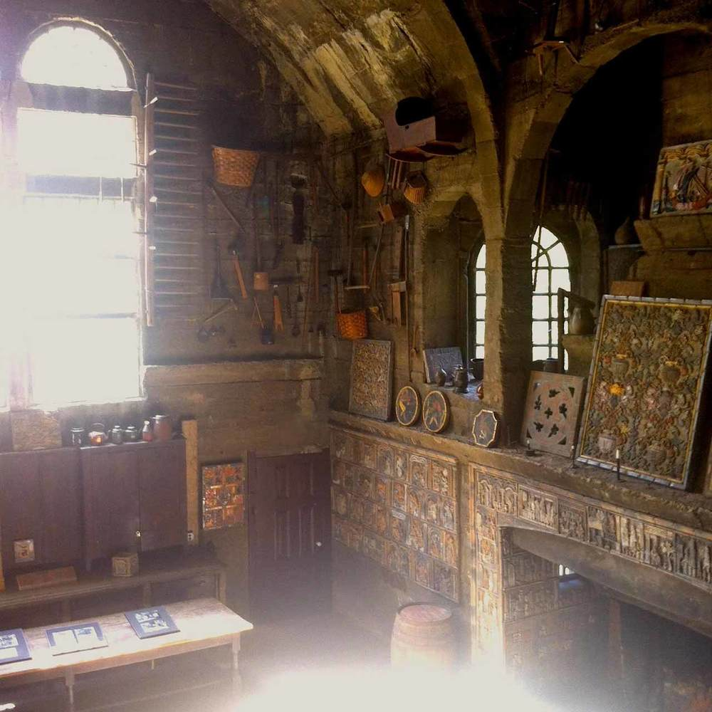 A look inside the stunning, high-ceiling ceramic studio, filled with antique treasures and original tile work.