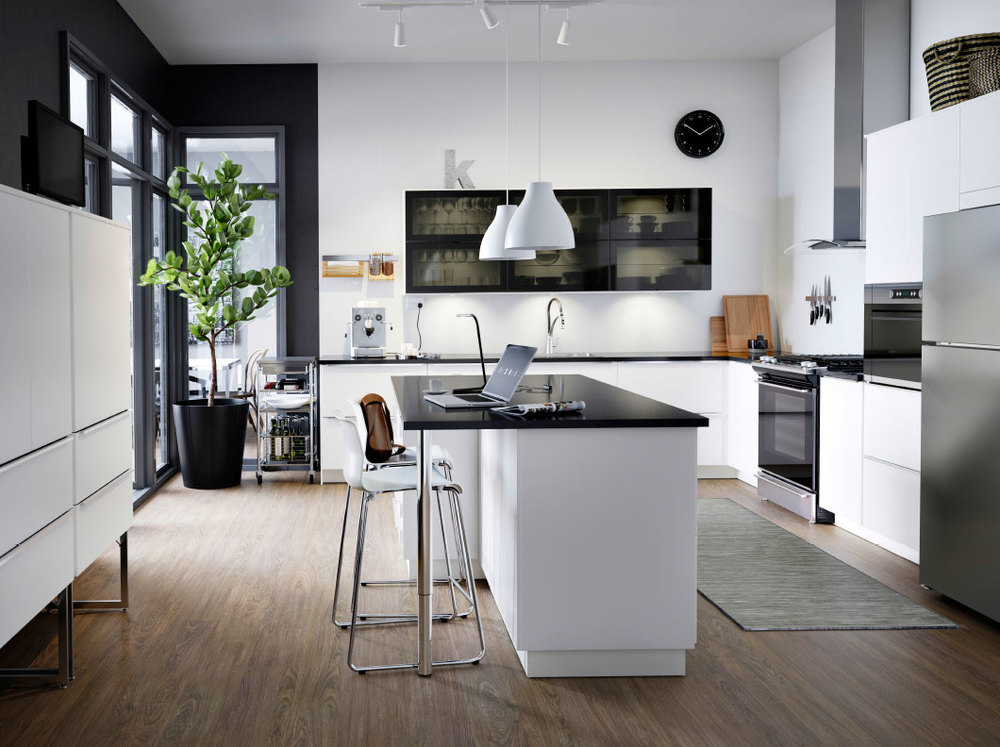 The JUTIS glass doors feel sleek and modern. Image via IKEA.