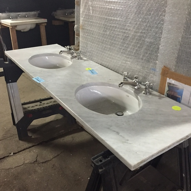 Marble vanity top with double sinks and faucets - $750.