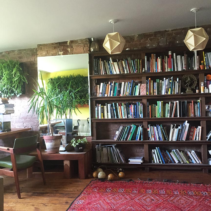 Upstairs, the spacious office-library is filled with sunlight and lots of plants.