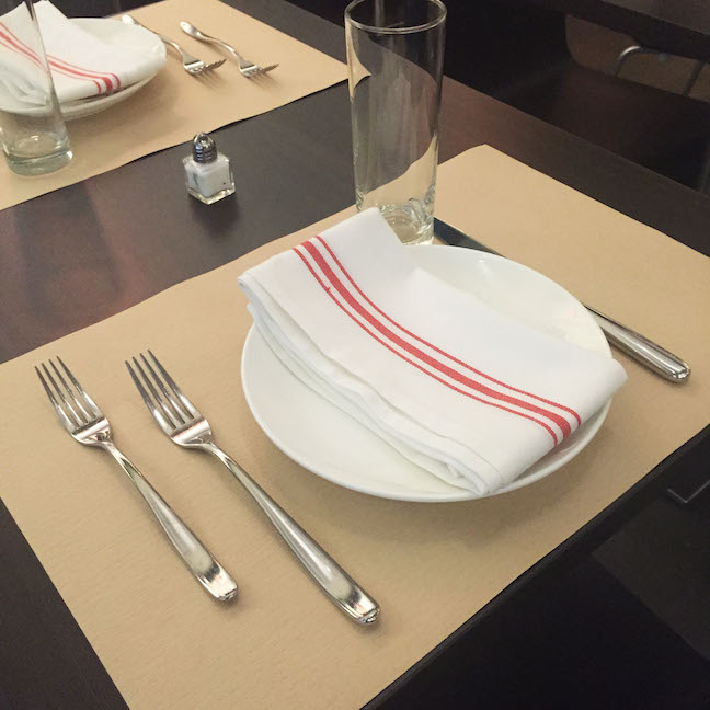 The simple table setting features recycled paper place mats.