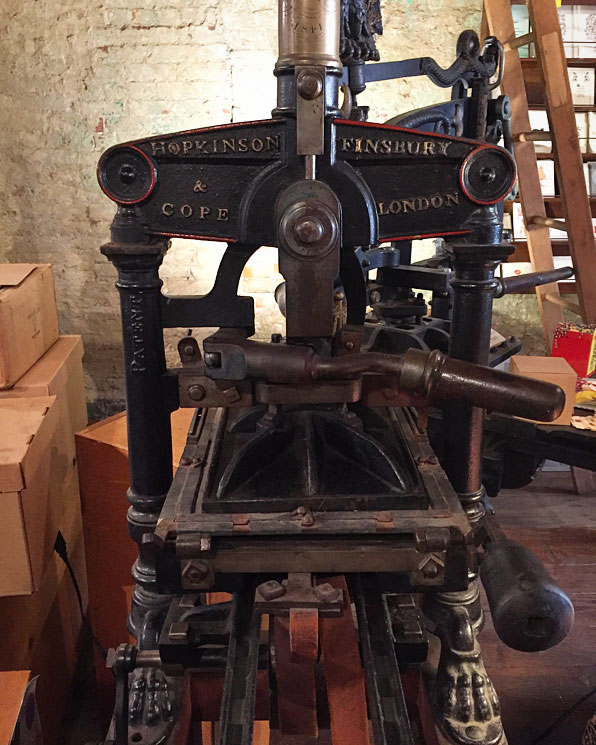 A heavy iron press. Image via  @lweatherbee .