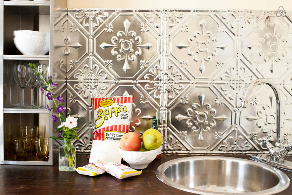 According to the reviews, snacks and drinks are provided as amenities. I also love the tin tile backsplash!  Image via   Airbnb