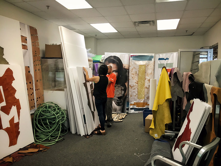 Jean preparing her latest exhibition. Image via  @lweatherbee