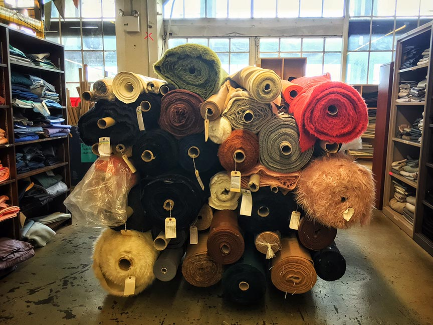 Rolls of fabric donations from the fashion industry. Image via  @lweatherbee
