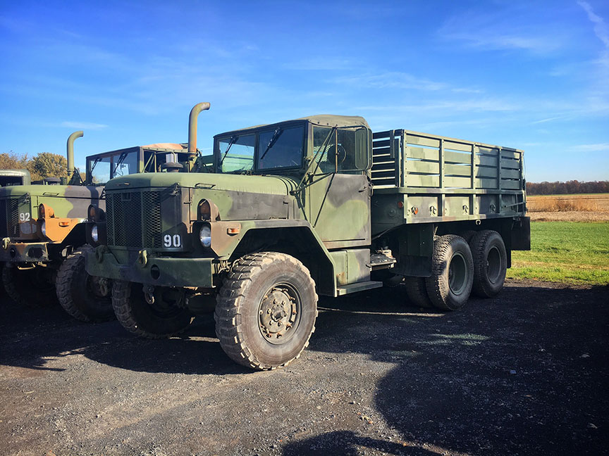 The Minkus family found these sweet army trucks on Ebay for a bargain price, and use them for harvesting.