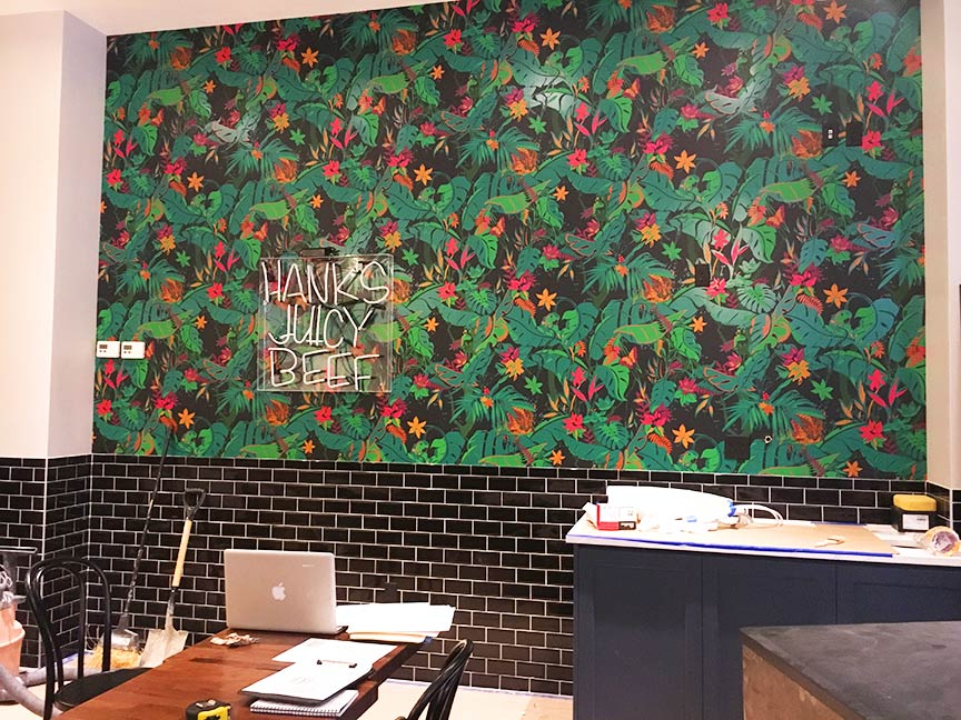 Finally the accent wallpaper is in place! This definitely added a lot of punch to the design, and was the most exciting reveal. The wallpaper is from Flavor Paper, and was screen printed by hand in Brooklyn. The neon sign is up, but not yet lit. The bright pink sign will be the perfect complement to the green wallpaper.