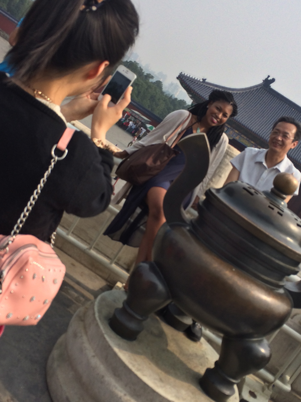 I was sitting on the rail and people came up to me and started taking pictures with me! @ Temple of Heaven, Beijing