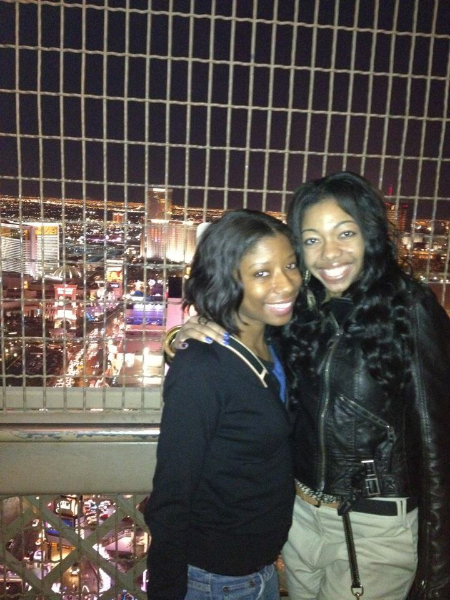 Erin and I on top of the Eiffel Tower | Being enclosed behind the fencing cramped my style a tad!