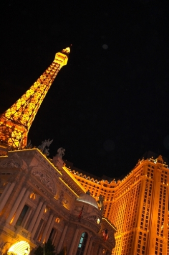 Las Vegas's Paris Hotel & Casino lit golden by night