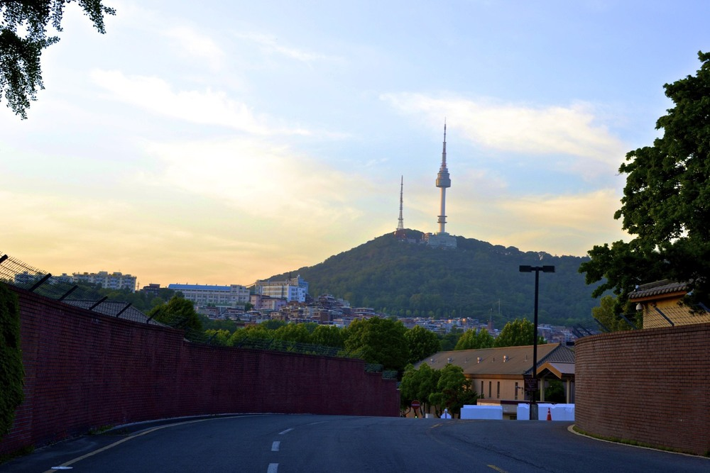 View of N Seoul Tower/Namsan Tower from the outskirts of US military base   Source: alexis-jenkins.squarespace.com