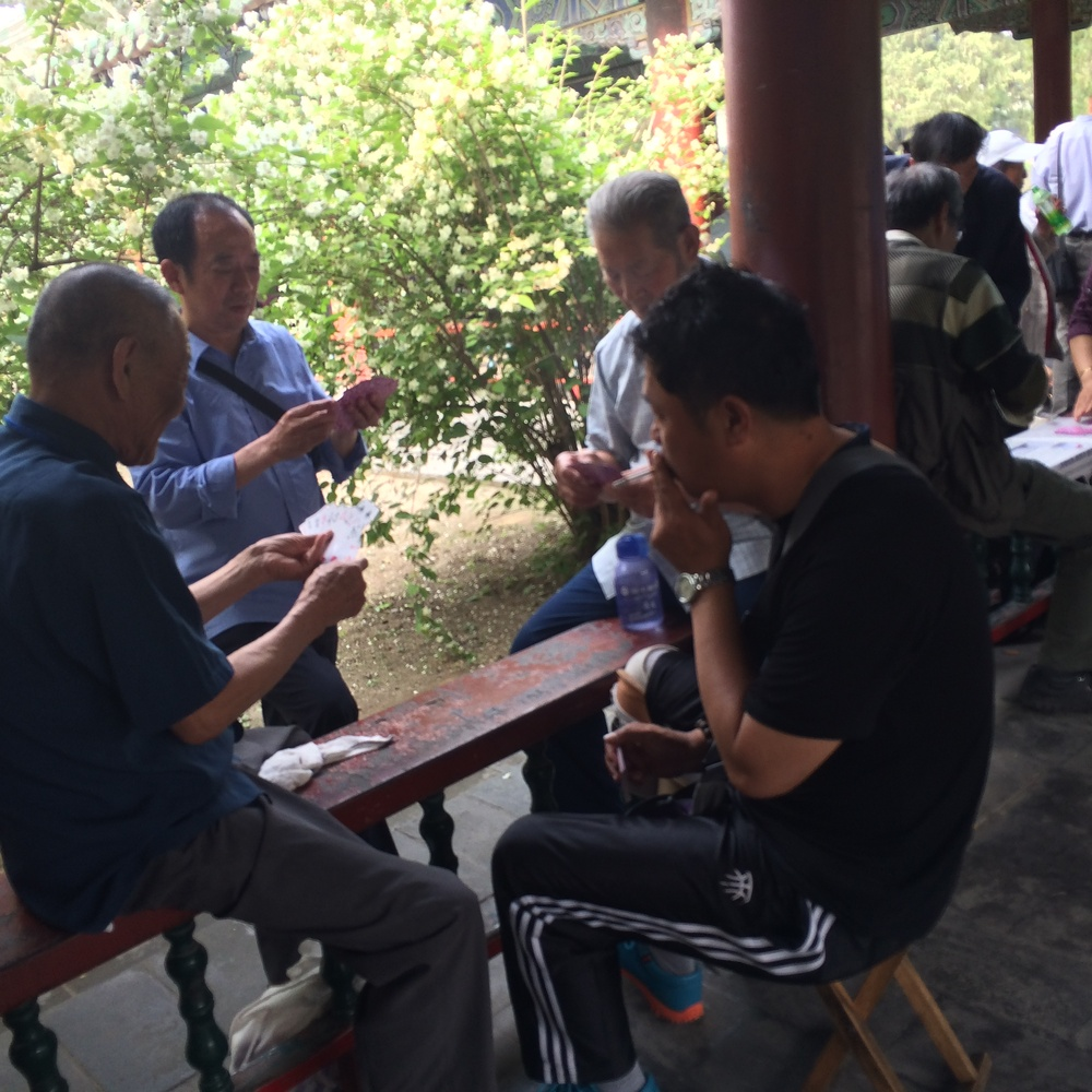 It was a social event for the Chinese - here they are spotted playing a game of cards1