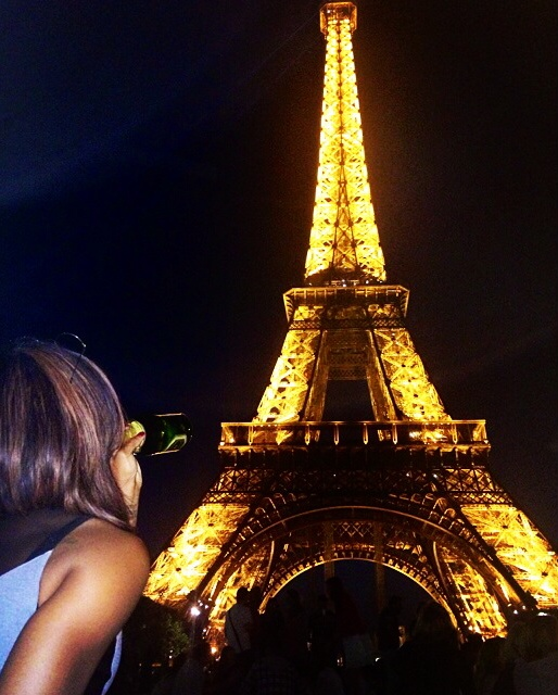 Watching the Eiffel Tower light up on the last night of our trip. Paris, France.