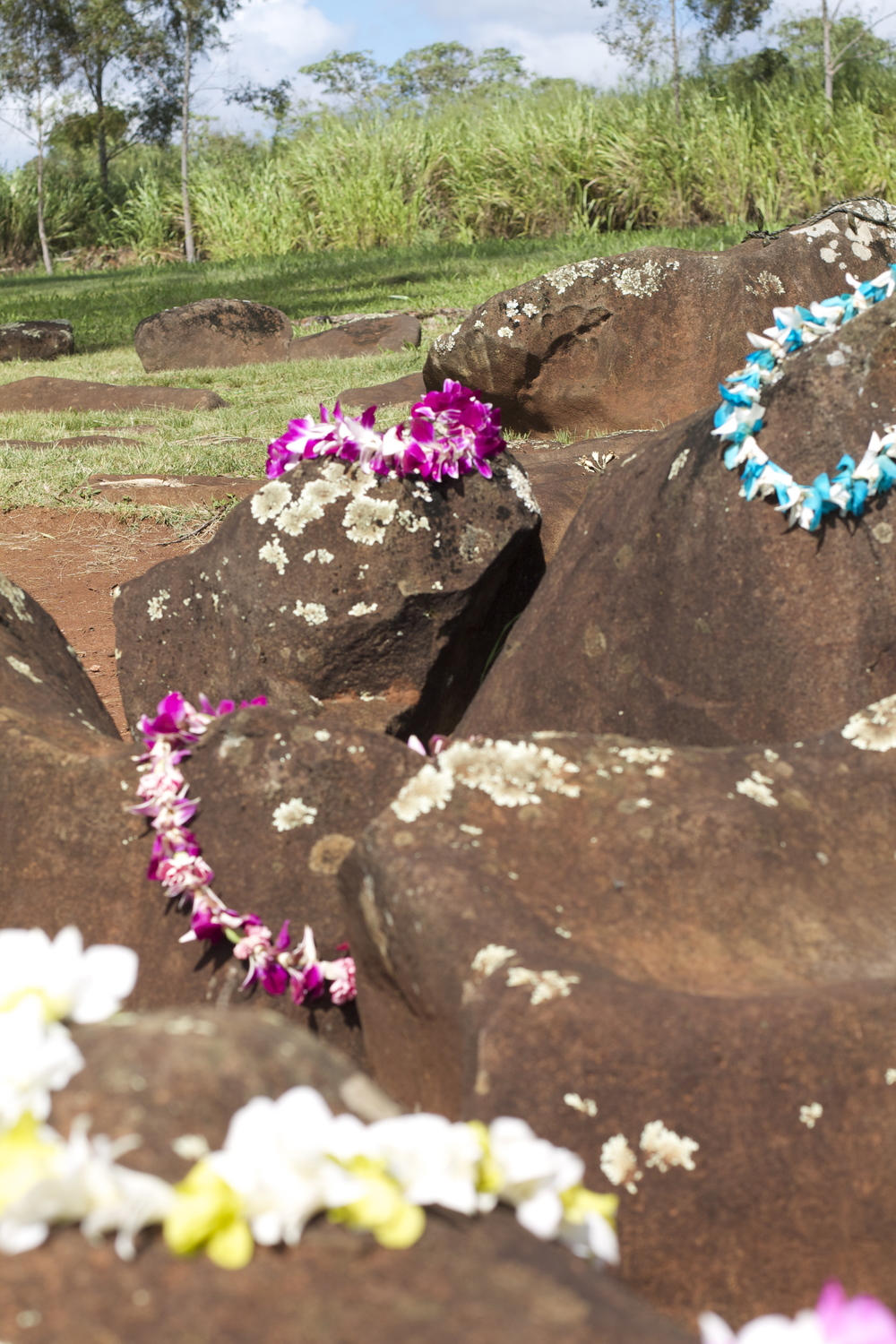 Locals stop by and leave Lei offerings as blessings on the ancient birth stones