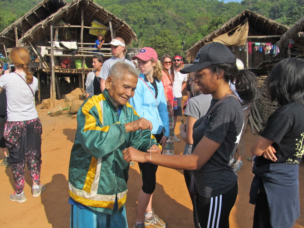 Receiving my good luck bracelet from the village OG.