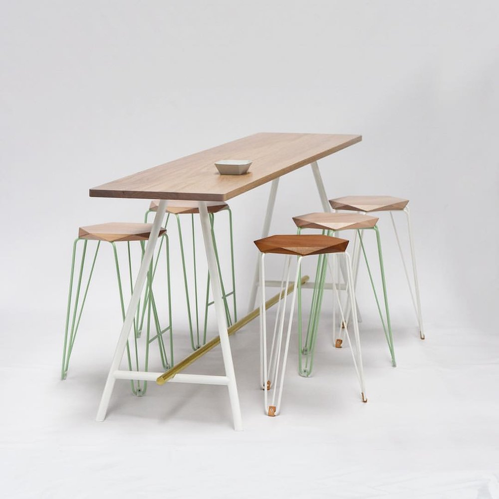 Tuckbox Design Rex stools and a custom table from the Truss range