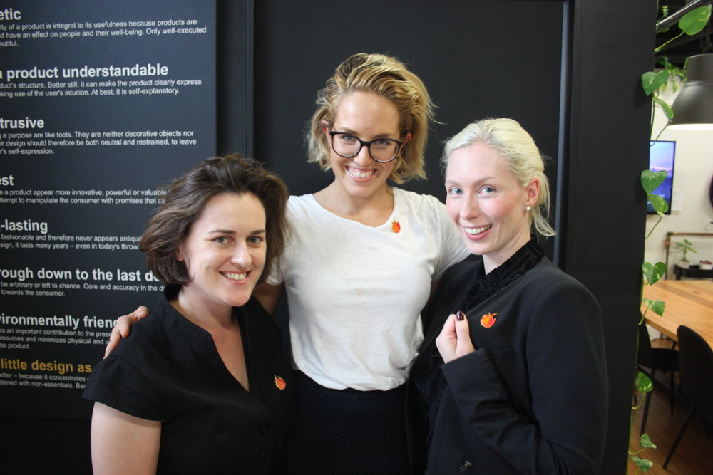 L to R: Felicity Davidson, Alex French and Sara Pontopiddan show off their orange FUEL flame pins