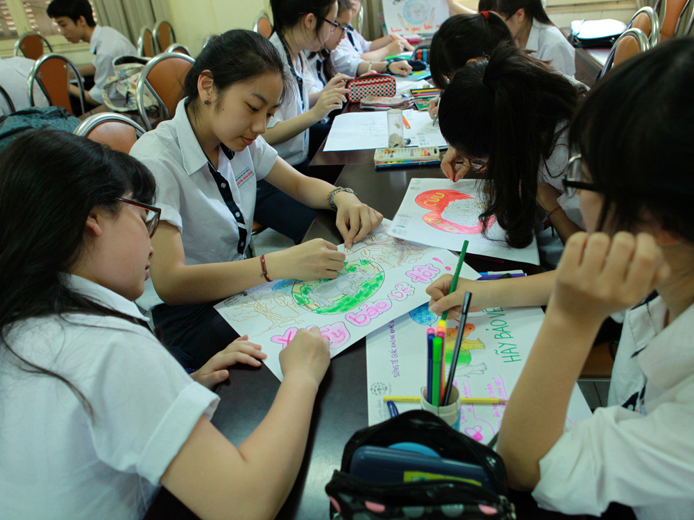 Students at Tran Phu high school working on their entries