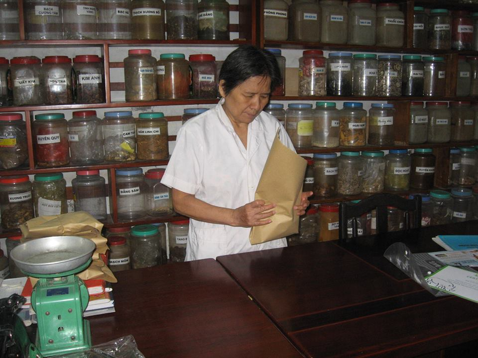 Dr. Thuan is preparing some Vietnamese Traditional Herbal Medicine for her patients