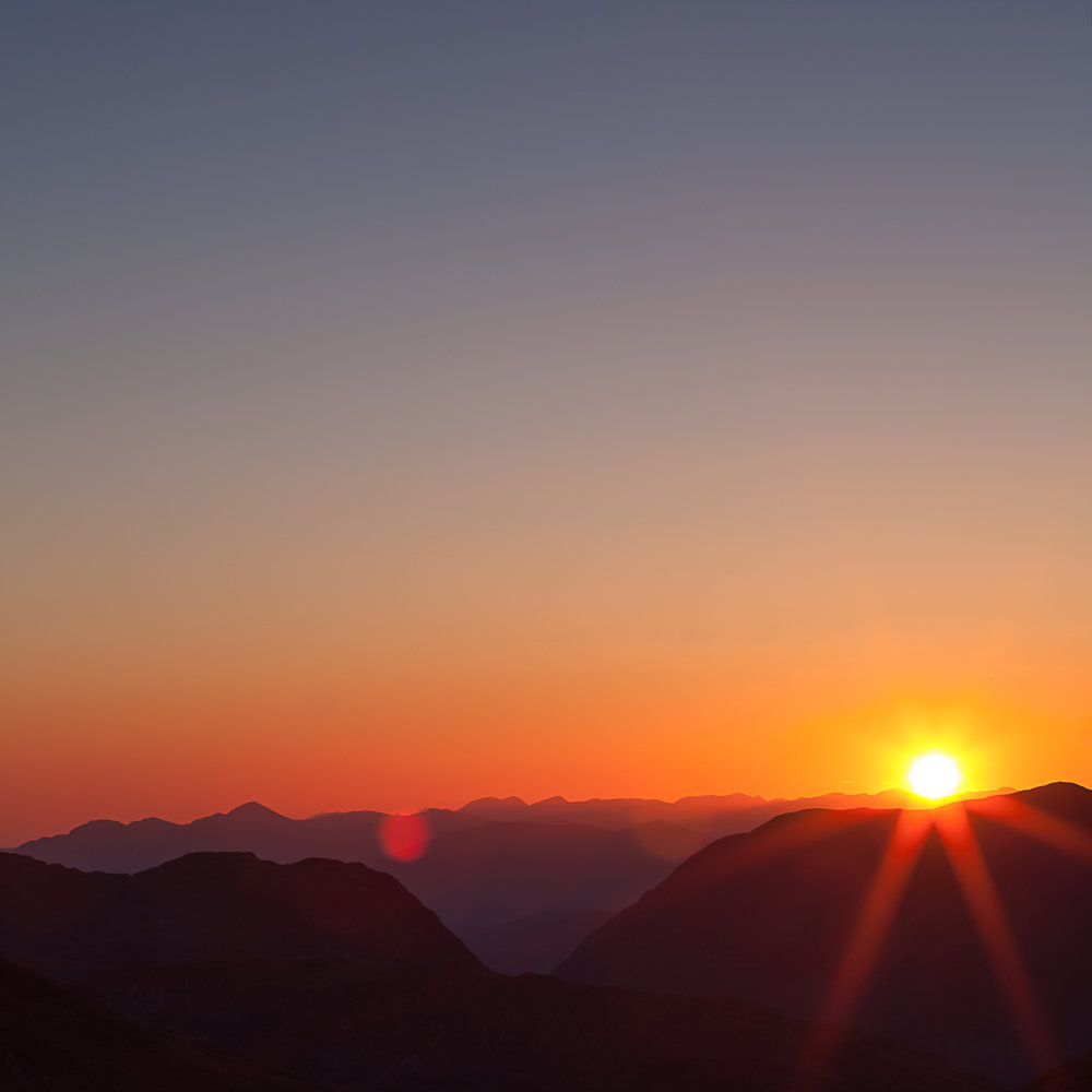 Setting sun over the Glencoe range. A beautiful camping spot on top of Stob na Doire.