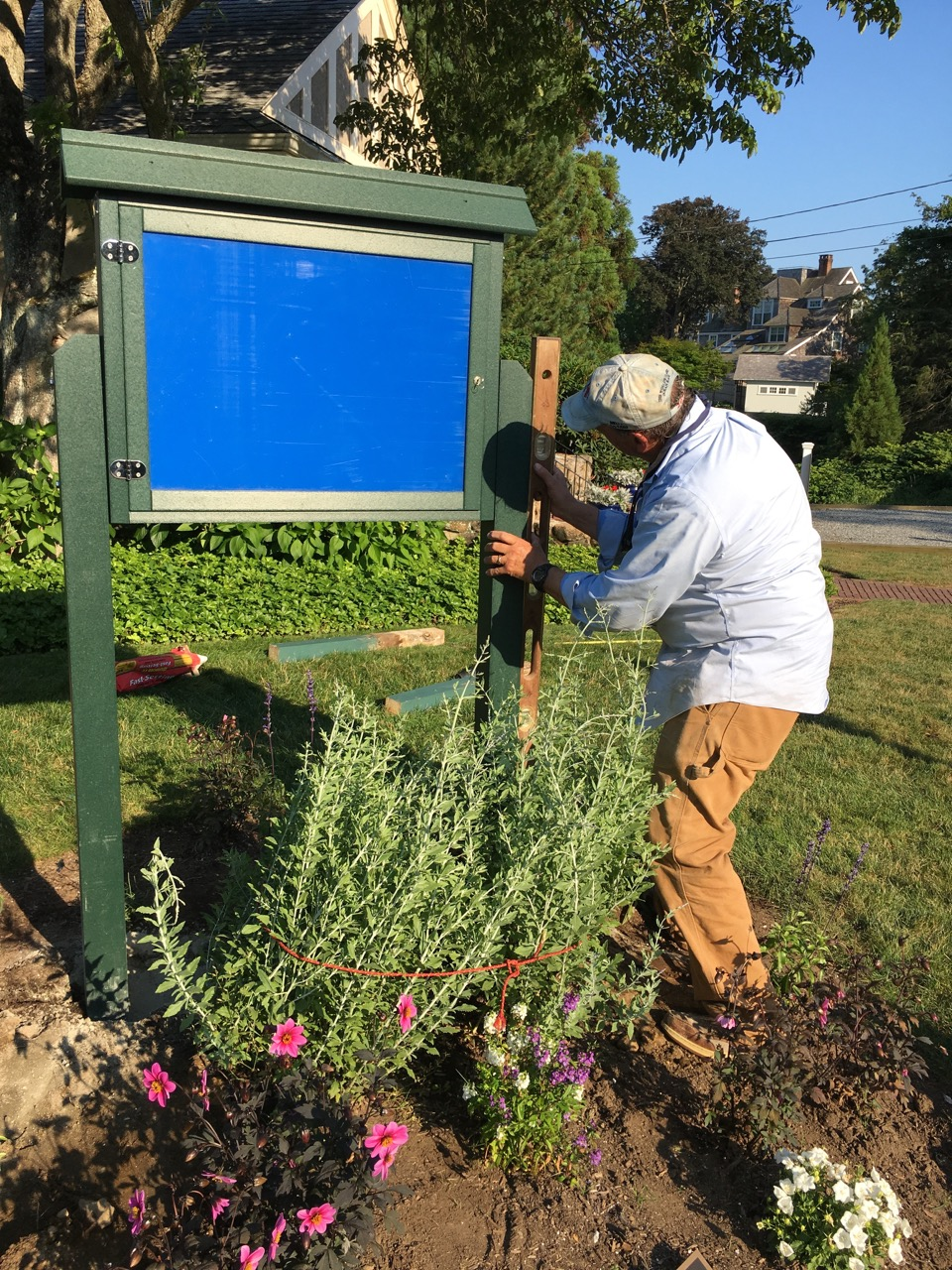 Grant Simmons installing the new Information Board