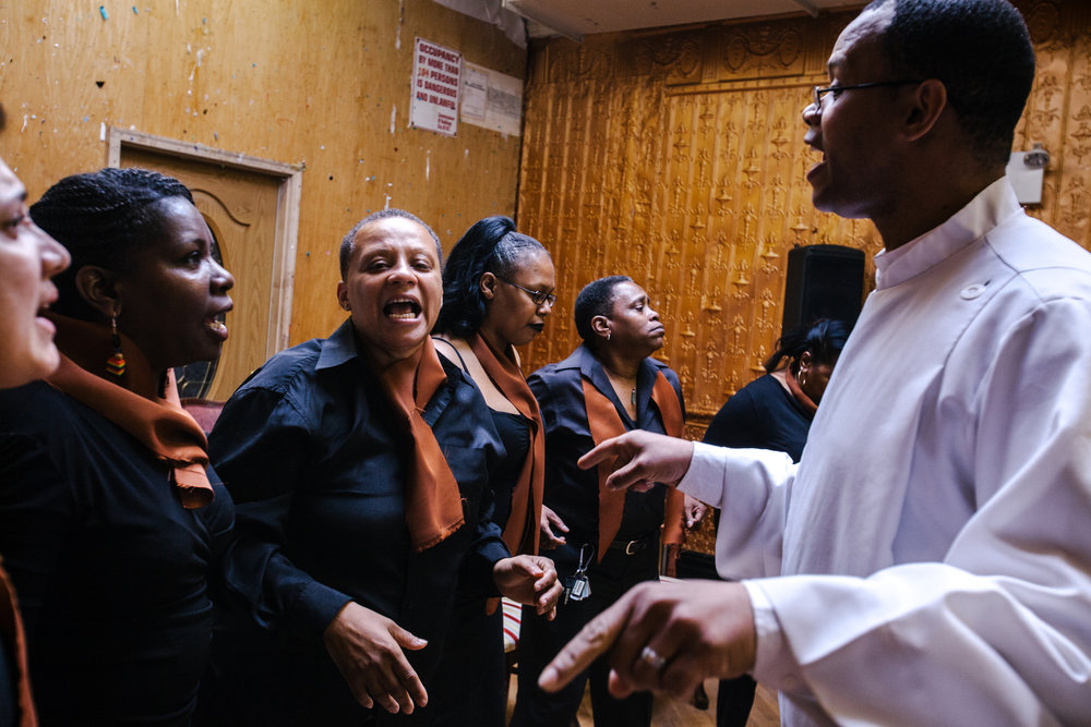 The choir performs at In The Life's eighth anniversary. The church was originally founded in the now-defunct South Bronx-based Bronx Community Pride Center. To avoid anti-LGBT stigma prevalent in the South Bronx, the pastor moved the church to its current location in a ramshackle building in the far east Bronx.