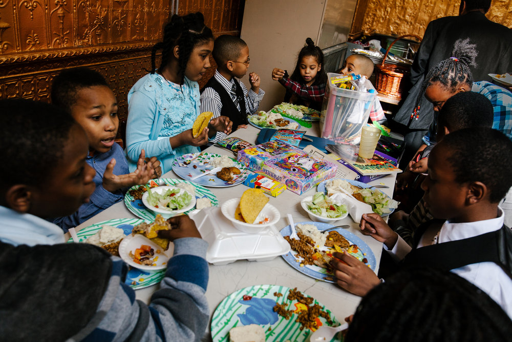Children eat after the church's annual children's mass. Though the vast majority of the congregation identify as LGBT, many of its members have children from previous relationships or marriages.