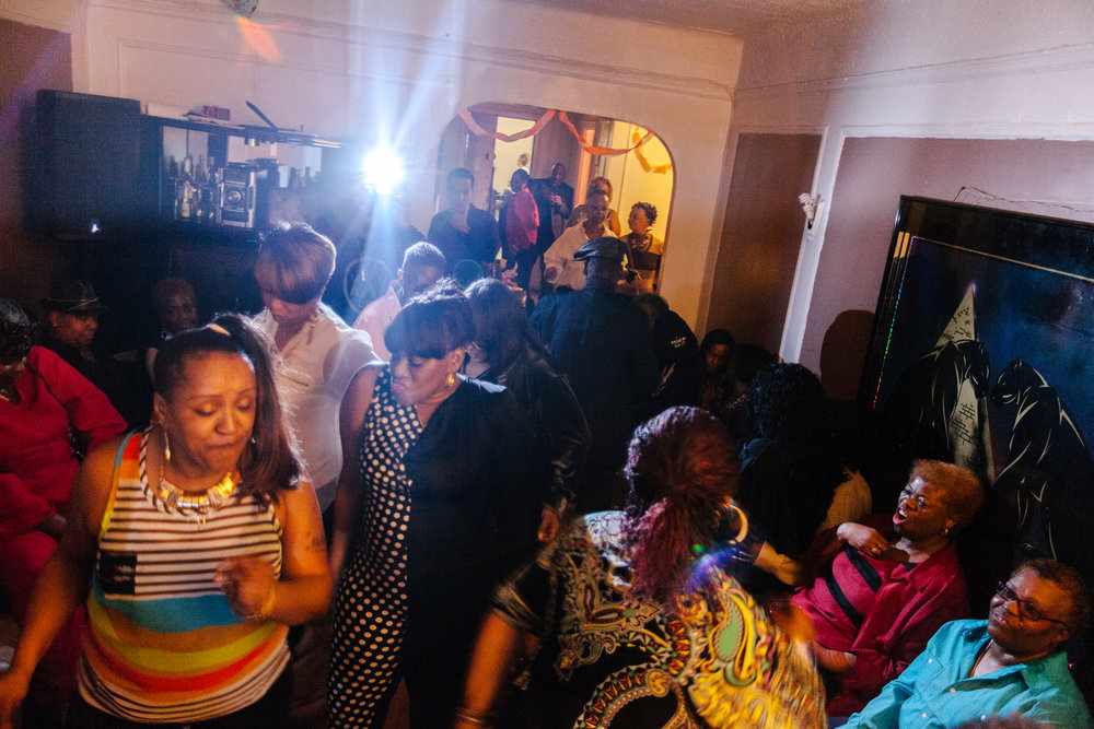Members of the congregation and others from the Bronx LGBT community dance at a Lorraine's birthday party.