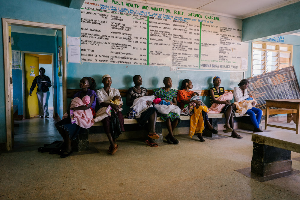Women and their babies wait at the Bumula Health Center. It serves approximately 45,000 people in the area and it was where Consolata was initially brought after the botched abortion. Her injuries proved too serious and she was referred elsewhere.