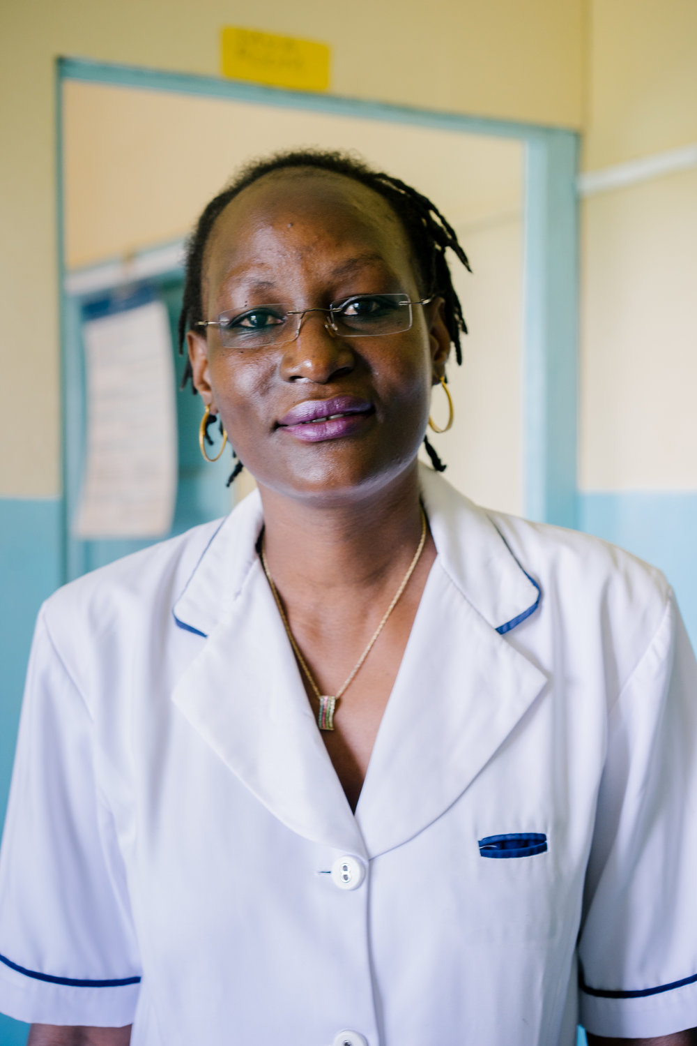 Ruth Owino poses for a portrait. She says despite the law, if a girl or woman comes to her asking for an abortion, she will not turn them away. Better to have a safe procedure than risk injury or death at the hands of a quack.