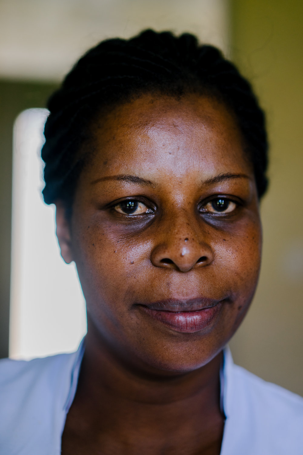 Susan Wanyama, a nursing officer at the Bokoli Hospital in western Kenya poses for a portrait. She offers clandestine abortions to women in need.