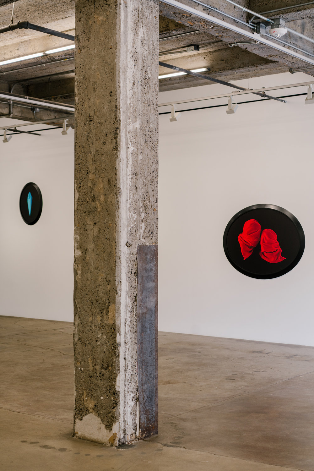 """""""Anti-Gravity,"""" and """"Red Veils,"""" by Sarah Charlesworth from the exhibition """"Natural Magic,"""" at Maccarone gallery."""