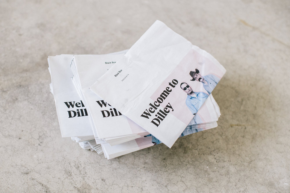 A stack of zines from the Welcome to Dilley project.